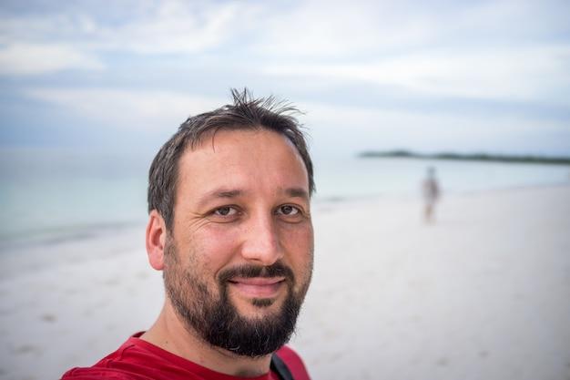 Adult man portrait on tropical beach