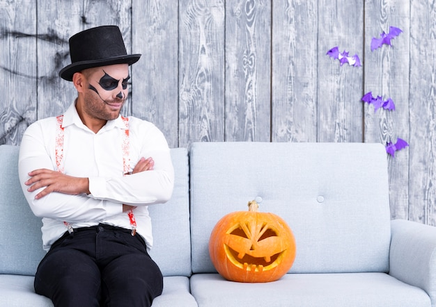 Adult man staring at halloween pumpkin