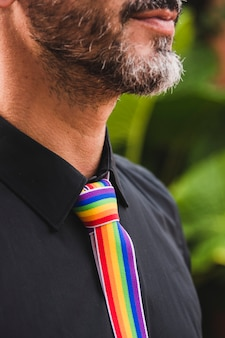 Adult man with tie in lgbt colors