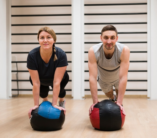 Adult man and woman exercising together