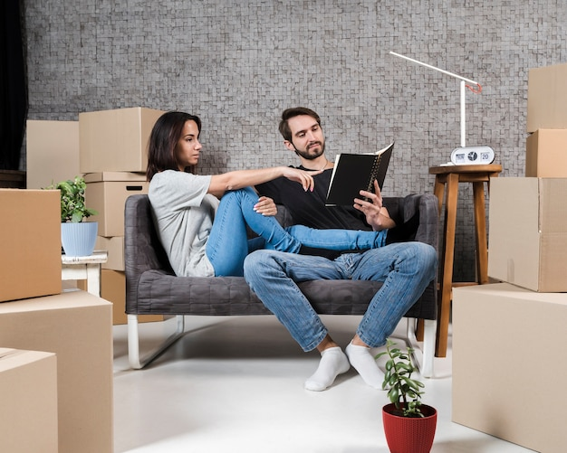 Adult man and woman planning relocation together
