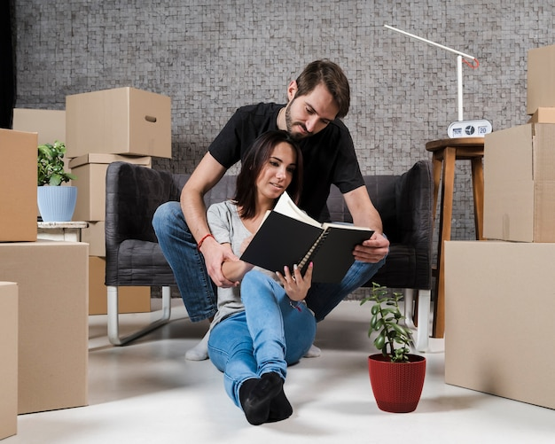Adult man and woman planning relocation