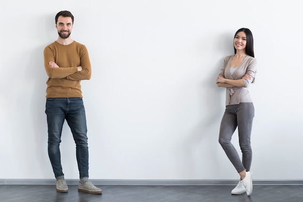 Adult man and woman posing together