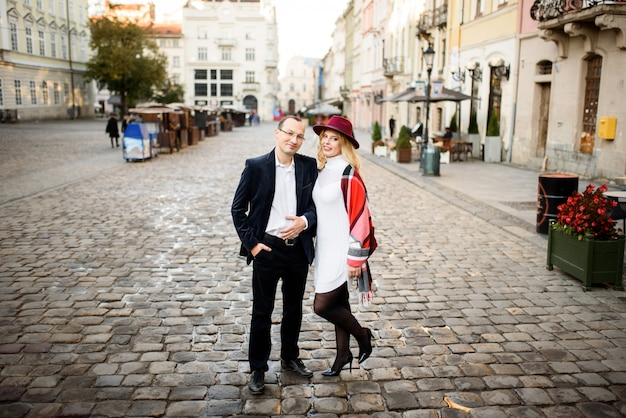 Adult married couple walks the streets of the old city. tourism concept.