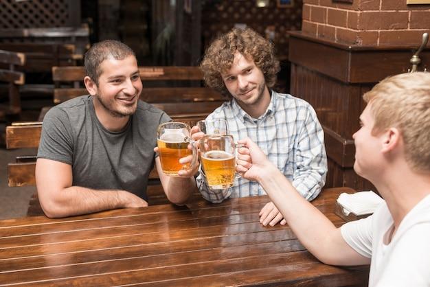 Adult men celebrating in bar