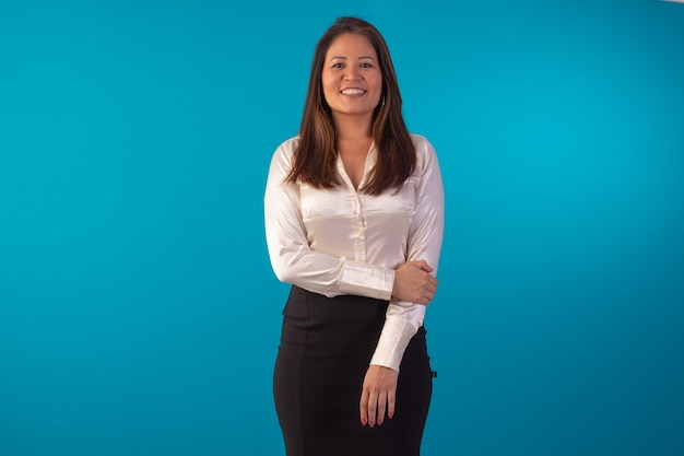 Adult oriental woman wearing formal wear in studio photo with blue background.