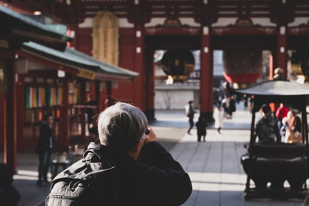 Adult people photographer journalist travelers take photo asakusa temple, locate of kaminarimon of sensoji
