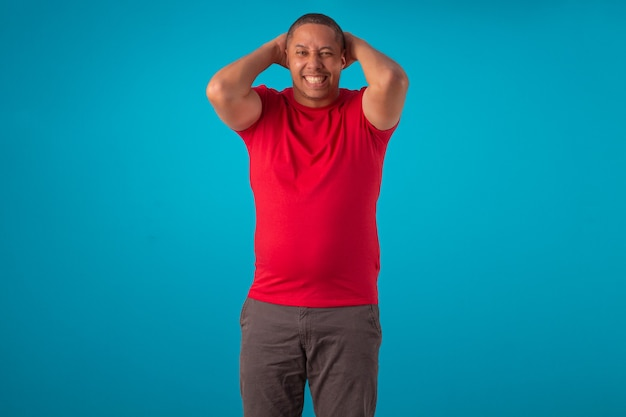 Adult in red shirt on a blue background, making various facial expressions.