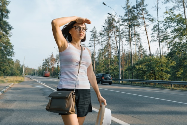 Adult serious woman looking at the road