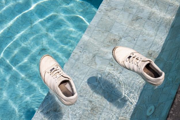 Adult sneakers swim in the pool