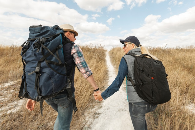 Adult travelers holding hands outdoors