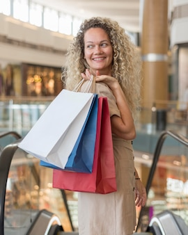 Adult woman carrying shopping bags at the mall