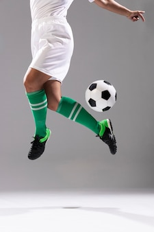 Adult woman doing tricks with soccer ball