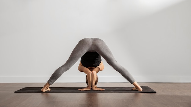 Adult woman doing yoga at home