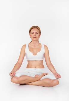 Adult woman doing yoga, woman sitting in meditation yoga pose