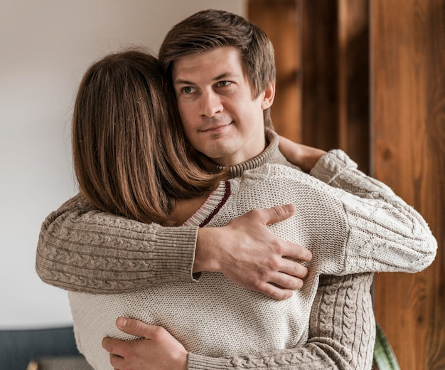 Adult woman hugging her husband