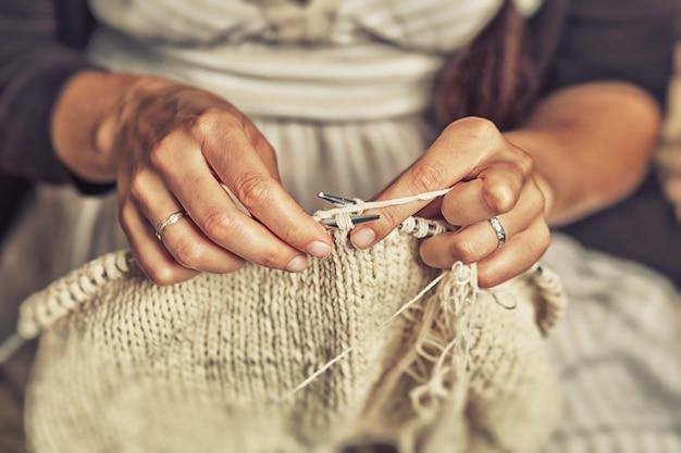 Adult woman knits