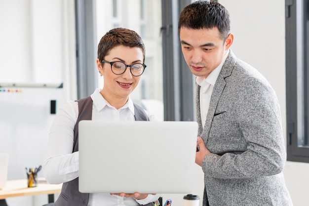 Adult woman and male working together