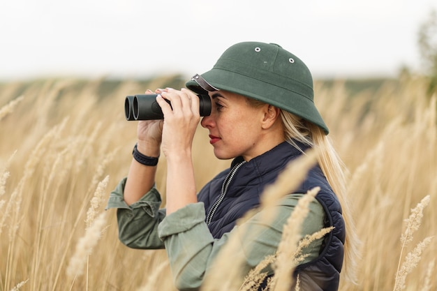 Adult woman outdoors with binoculars