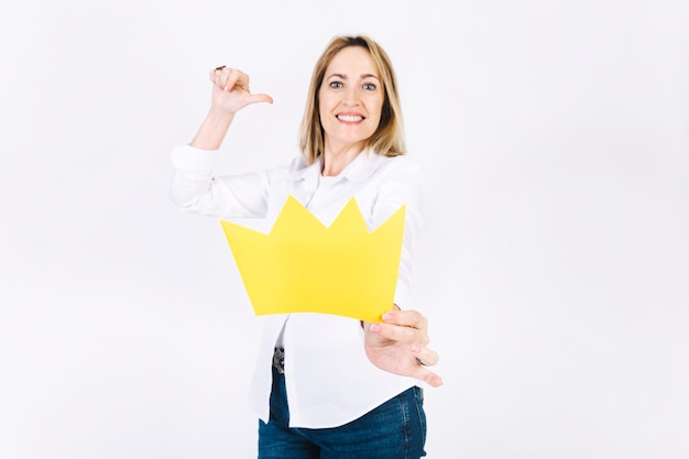 Adult woman showing paper crown
