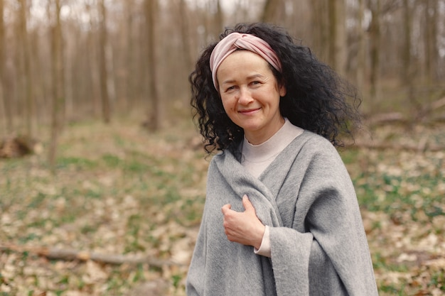 Adult woman in a spring forest