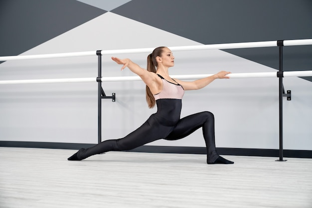 Adult woman stretching in ballet studio