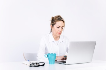 Adult woman typing on laptop