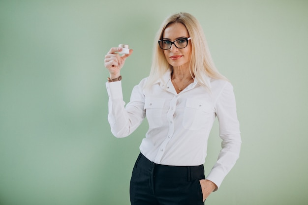 Adult woman using anti aging cream