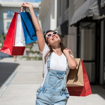 Adult woman walking with shopping bags