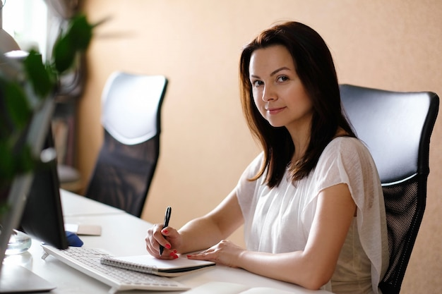 Adult woman working at office