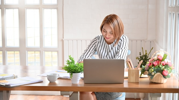 Adult woman working with digital tablet and pen.