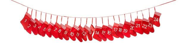 강림절 달력 1-24. 흰색 바탕에 크리스마스 양말입니다. 붉은 장식