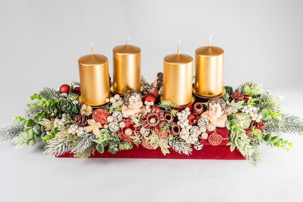 Advent composition with candles, table handmade arrangement mini decoration for new year, artificial christmas tree interior decoration