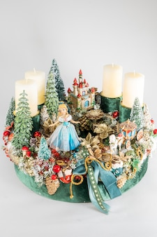 Advent wreath with candles, table handmade arrangement mini decoration for new year, artificial christmas tree interior decoration