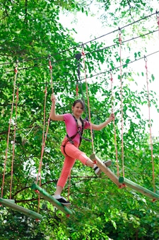 Adventure climbing high wire park - hiking in the rope park girl