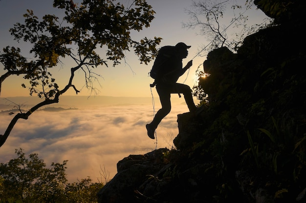Adventure hiking, mountain landscape with person climbing