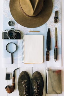 Adventure planning flat lay including hat and boots with copy space