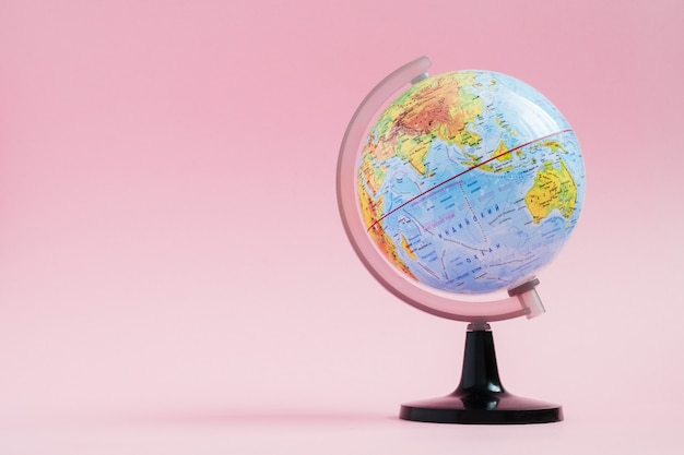 Adventure stories education with world globe on pink background