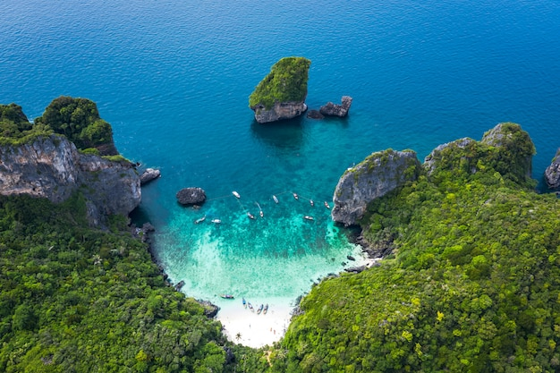 Adventure style hi season thai and foreign travel trip tourists long tail boat and driving see coral