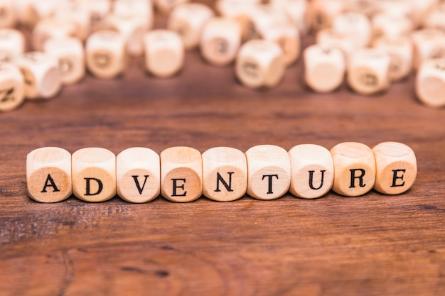 Adventure text arranged with wooden cubes