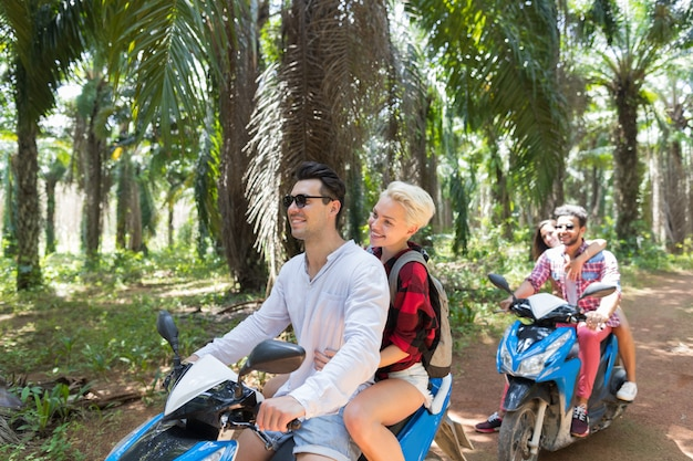 Adventure on vacations: two young couples on scooter travel