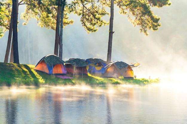 Adventures camping and camping in the morning with light fog at pang-ung, mae hong son, thailand