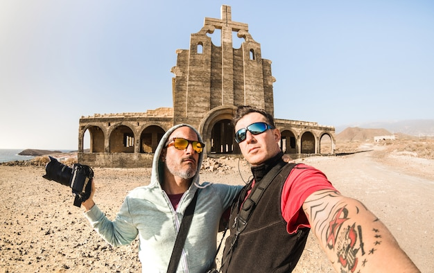 Adventurous best friends taking selfie at abandoned place in tenerife