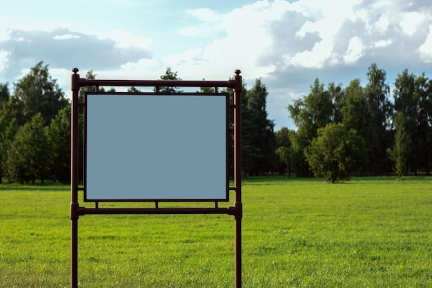 Advertise billboard in the park for your ad copy space empty frame summer day