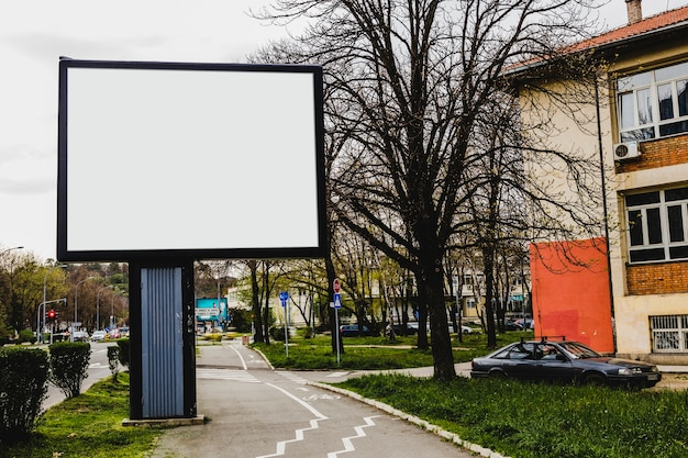 Advertisement billboard in front of apartment building in the city