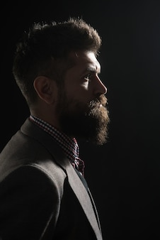 Advertising barbershop concept. silhouette of serious bearded man in vintage style. classical vintage male portrait. vintage fashion.