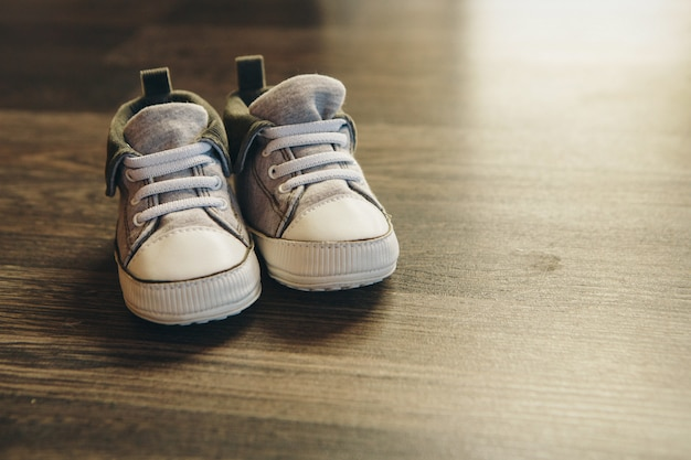 Advertising children's shoes: sneakers are on the floor