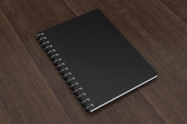 木製のテーブルの上の広告またはブランディングテンプレート空白のノートブック黒のモックアップ。 3dレンダリング。