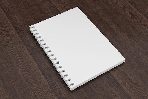 木製のテーブルの上の広告またはブランディングテンプレート空白のノートブック白いモックアップ。 3dレンダリング。