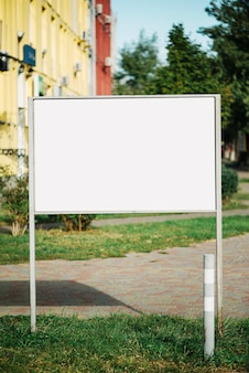 Advertising panel near path